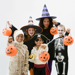 Kids trick-or-treating in Halloween costumes