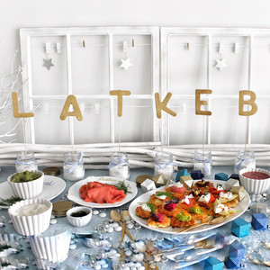 Host a Hanukkah Party With Mouthwatering Latkes, Decorative Dreidels, and a DIY Sign