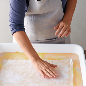 Gently lay medium flat onto size, and pat to remove air bubbles.