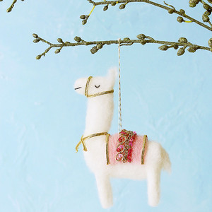 needle felted llama ornament hanging from sparkly branch