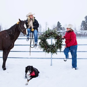 women wreath dog snow