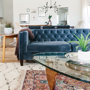 layering rugs and blue couch