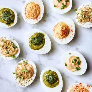 four variations of rich deviled eggs