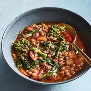 vegan lentil soup in bowl on blue table