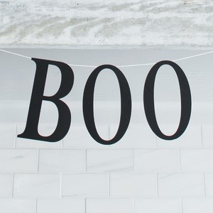 "A simple ""BOO"" banner made with cardstock lettering, a glue gun, and string."