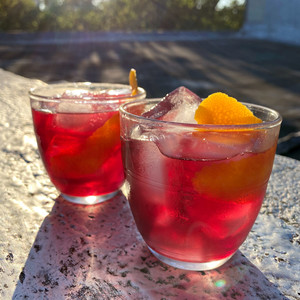 red wine spritzers with orange peels
