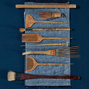Weaving combs, calligraphy brushes, and other domestic items from Japan.