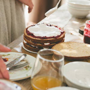 Layers upon layers of whipped cream and fresh berry jam.