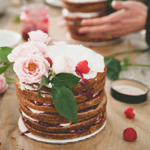 A fluffy crescent of food-safe flowers are the finishing touch.