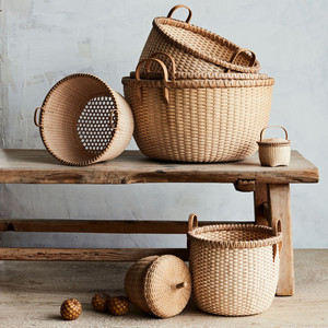 assorted woven baskets on wooden bench