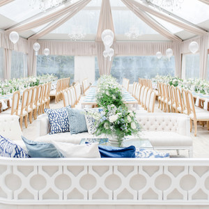 charitable baptism celebration decor and seating inside of tent