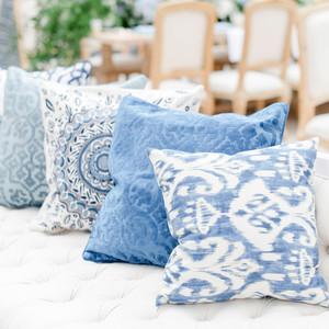 charitable baptism celebration blue pillows decor detail