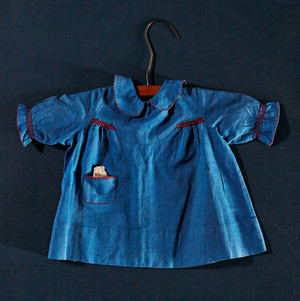 An American doll's dress with smocking, from circa 1950.