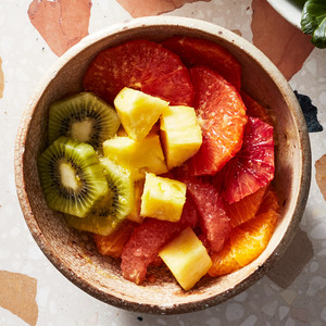 tropical fruit juice salad with pineapple and kiwi