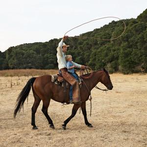 father son horseback ranch life