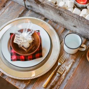 eli lumberjack birthday party place setting with marshmallow centerpiece