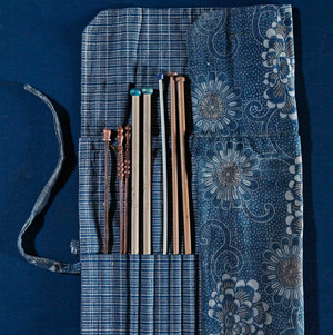 A handmade knitting-needle case made out of antique Japanese fabric.