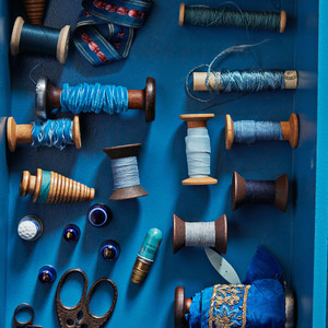 Bobbins and spools of thread with antique thimbles from France.