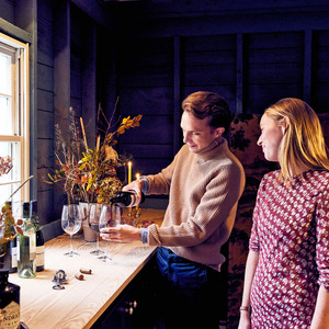 man pouring wine for woman