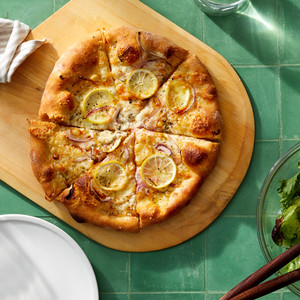 lemon cheese pizza on cutting board