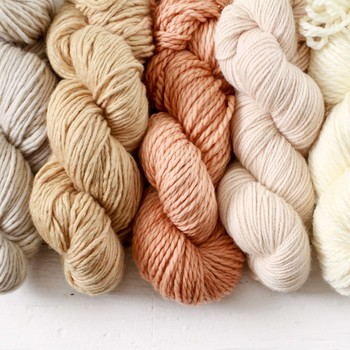 four assorted colors of dyed yarn