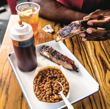 plate with ribs, baked beans, and rub