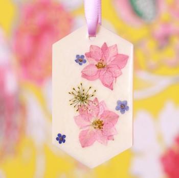 wax sachet hanging by ribbon