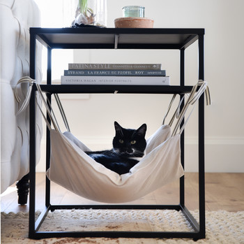 close up diy cat hammock with cat peeking out