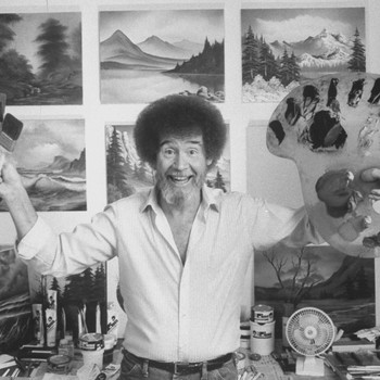 bob ross in front of landscape paintings in his studio