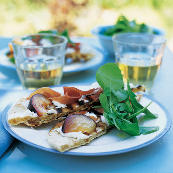 Grilled Pizzas with Plums, Prosciutto, Goat Cheese, and Arugula