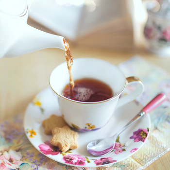 pouring tea in tea cup