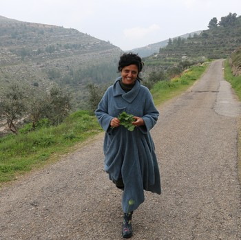 Vivien Sansour, founder of the Palestine Heirloom Seed Library, walks along a mountain pass