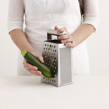 Box grater with zucchini