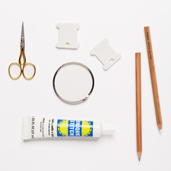 embroidery tools against a white background