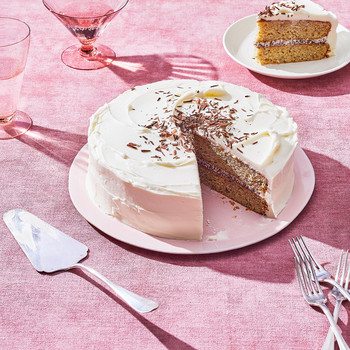 banana cake sliced on a table with a pink table cloth
