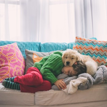 kid and dog sleeping
