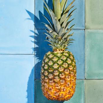 pineapple on blue tile