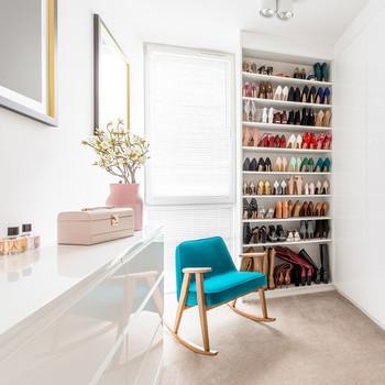 blue rocking chair beside shoe closet