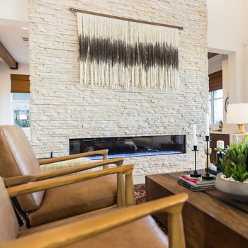 textile art hanging above fireplace