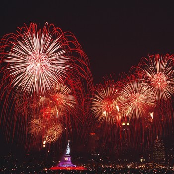 fireworks over the Statue of Liberty in NYC