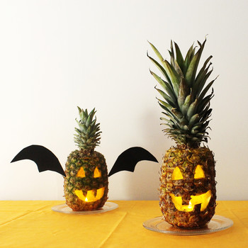 pineapple carved into a jack-o'-lantern