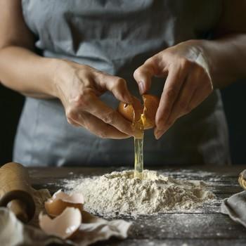Woman Cracking Eggs, Cooking Making Dough