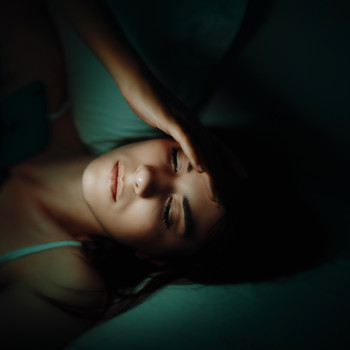 woman awake in dark room