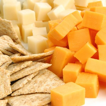 White and orange cheddar cheese on plate
