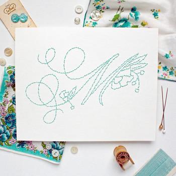 embroidered teal monogram