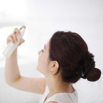 person using face mist