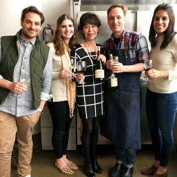 Freeman Winery founder and test kitchen editors showcasing wine