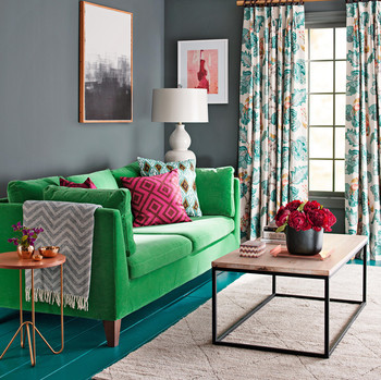 vibrant green couch in living area