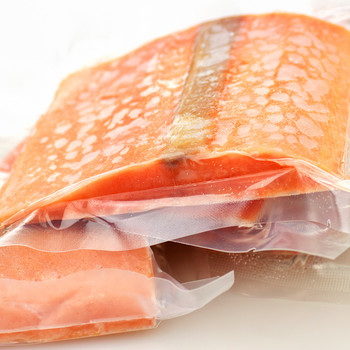 Frozen Salmon Steaks Wrapped in Plastic
