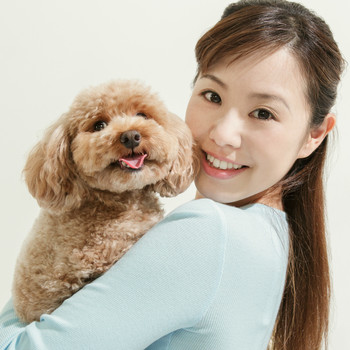 happy dog owner and poodle